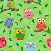 Seamless pattern with ornamental owls over light green — Stock Vector