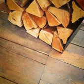 Firewood on old rustic floor — Stock Photo