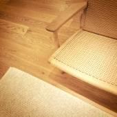 Rattan chair on wooden floor — ストック写真