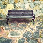 Wooden bench on colorful tile background — ストック写真
