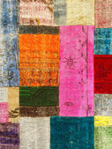Colorful vintage patchwork rug — Stock Photo