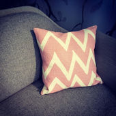 Pink cushion decorating a sofa — Stock Photo