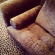 Velvet sofa on leopard carpet — Stock Photo #55905031