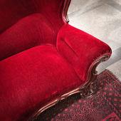 Classic red velvet sofa — Стоковое фото