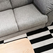 Gray sofa and wooden coffee table — ストック写真