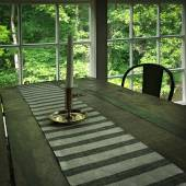 Interior of a rustic house with wooden table — Stock fotografie