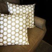 Polka dot cushions decorating a sofa — Stock Photo