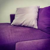 Purple velvet sofa with cushions — Stock Photo