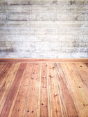 Interior with wooden floor and concrete wall — Stock Photo