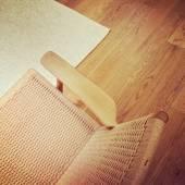Classic rattan chair on wooden floor — Stock Photo