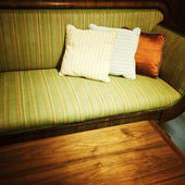 Old retro style sofa with cushions — Stock Photo