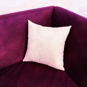 Fancy purple sofa with white cushion — 图库照片