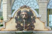 Statue of lion heads spout water. — Stock Photo