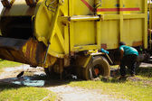 Garbage truck stuck in the mud — Stock Photo