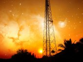High voltage power pole middle of a cornfield with orange sky and galaxy — Stock fotografie