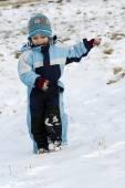 Child running in snow — Stock Photo
