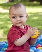 Child playing with balls — Stock Photo