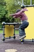 Child jumping at playground — Foto Stock