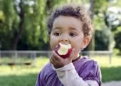 Child eating apple — Stock Photo