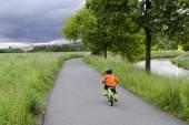 Child cycling — Stock Photo