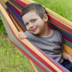 Child in hammock — Stock Photo #60085257
