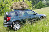 Car at farm with hay — Stock Photo