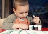 Child painting with brush — Stock Photo