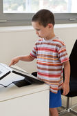 Child touching  touch screen computer — Stock Photo