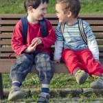 Children on bench — Stock Photo #64784745