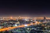 Blurred Bangkok highway cityscape at night. — Stock Photo