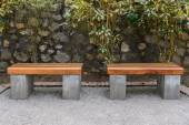 Wooden bench in public park open space. — Stock Photo