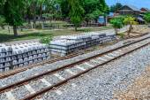 Stack of concrete railway sleepers near railroad. — Stock Photo