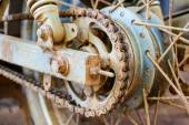 Old dirty motorcycle chain on wheel with rusty metal parts. — Stock Photo