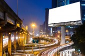 Blank billboard near expressway at night for advertisement. — Stock Photo