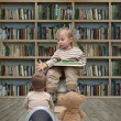Small reader and teddy bear — Stock Photo #59824673