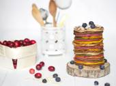Colorful pancakes and berries — Stock Photo