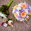 Bridal bouquet of roses and wedding accessories — Stock Photo #62729401