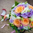 Bridal bouquet of roses and wedding accessories — Stock Photo #62729415