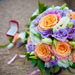 Bridal bouquet of roses and wedding accessories — Stock Photo #62729417