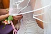 Bride lace up corset dress — Stock Photo