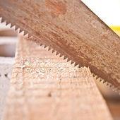 Saw sawing board closeup, Shallow depth of field — Stock Photo