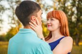 Young couple hugging in forest outdoors — Stock Photo