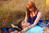 Young couple lying on the plaid in the park, close-up — Stock Photo