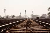 Distant man walking on railway track — Stock Photo