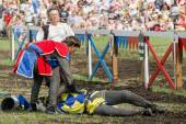 First aid to horseman at knights tournament — Stock Photo