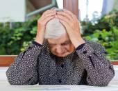 Unhappy elderly woman — Stock Photo