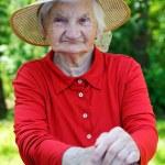 Happy elderly woman — Stock Photo #75716759