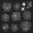 Set of 10 different spiderwebs and spiders on black background — Stock Vector #54071631
