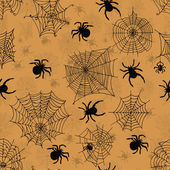 Vector seamless pattern with spiders on an orange background . Vector illustrations — Stock Vector