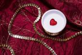 Red heart in a jeweler casket — Stock Photo
